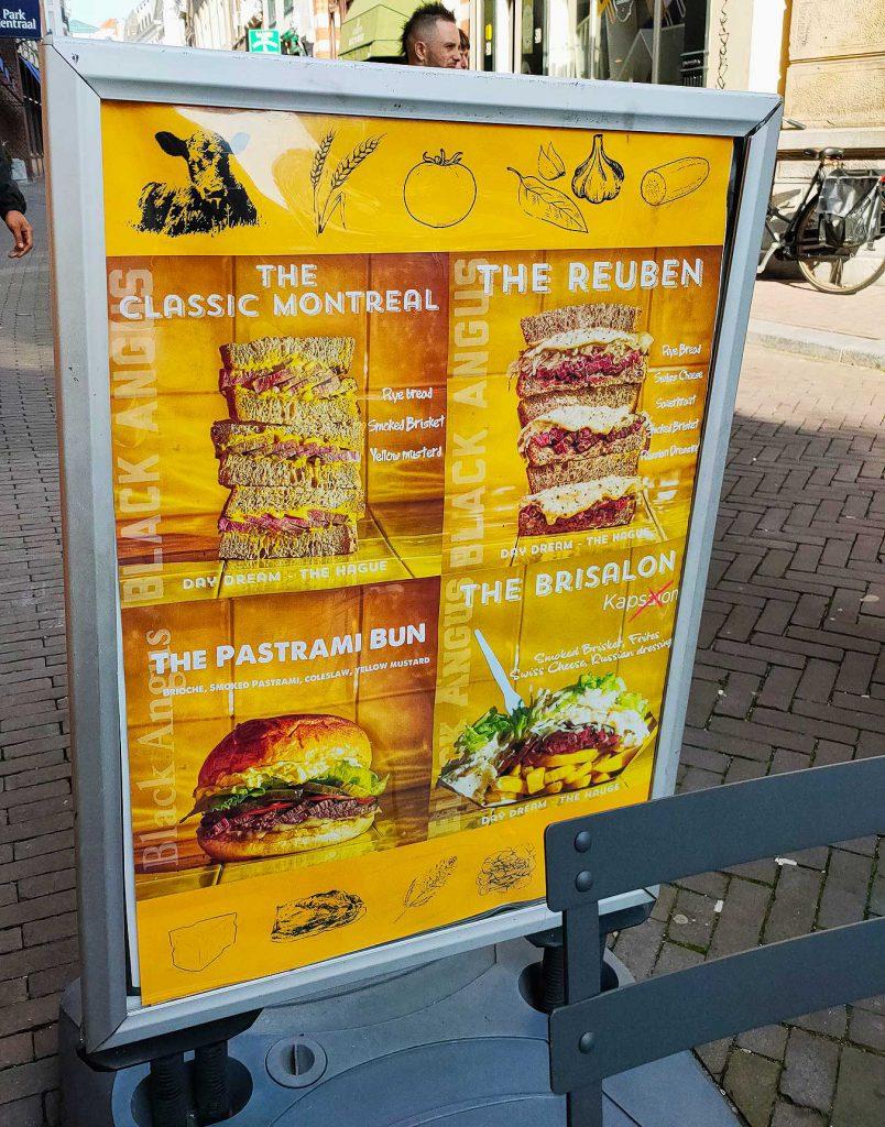 Day Dream Deli menu board on the street